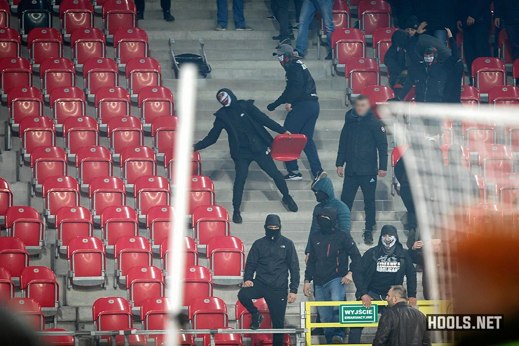 A GKS Tychy fan throws a seat at cops during the game against Ruch Chorzów.