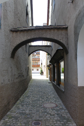 narrow street with arches
