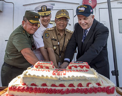 U.S. and Indonesian officials cut the ceremonial cake during a reception aboard USNS Mercy (T-AH 19), April 2. (U.S. Navy/MC2 Kelsey L. Adams)
