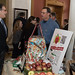 Rep. John Fusco talks with Brian Kelleher, of Easy Pickin's Farm, and a member of the Connecticut Apple Marketing Board, during the annual Agriculture Day at the state capitol.