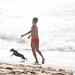 Exercising his human at Los Muertos Beach por Robert E. Adams
