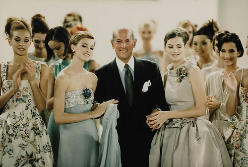 Designer Oscar de la Renta poses with models after the showing of his spring 1996 collection in New York, November 1995. AP Photo / Paul Hurschmann. From De la Renta's legacy of grace and elegance lives on