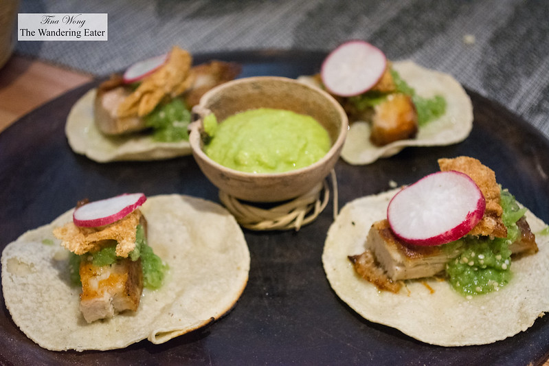 Suckling pig tacos with salsa verde and chicharrón
