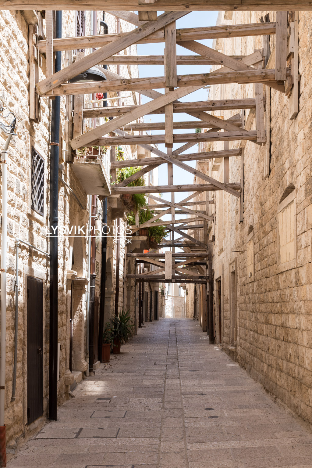 In Molfetta, a number of houses are supported with beams to prevent collapse