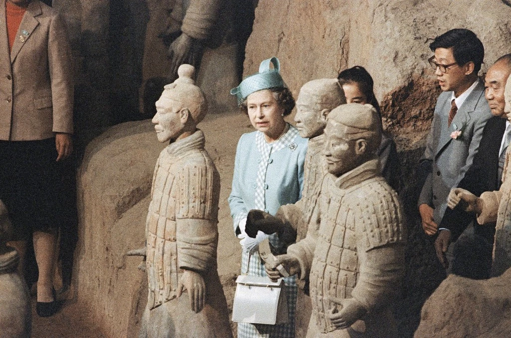 Queen Elizabeth II views the 2,000-year-old Terra Cotta Warriors during a visit to Xian, China, 1986.