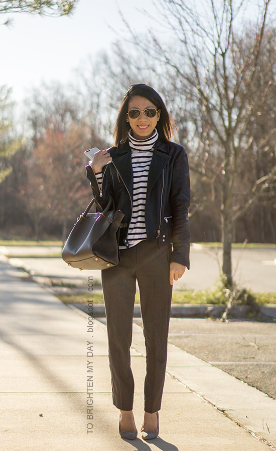 black leather jacket, striped turtleneck, gray wool trousers, gray suede tote, gray suede pumps