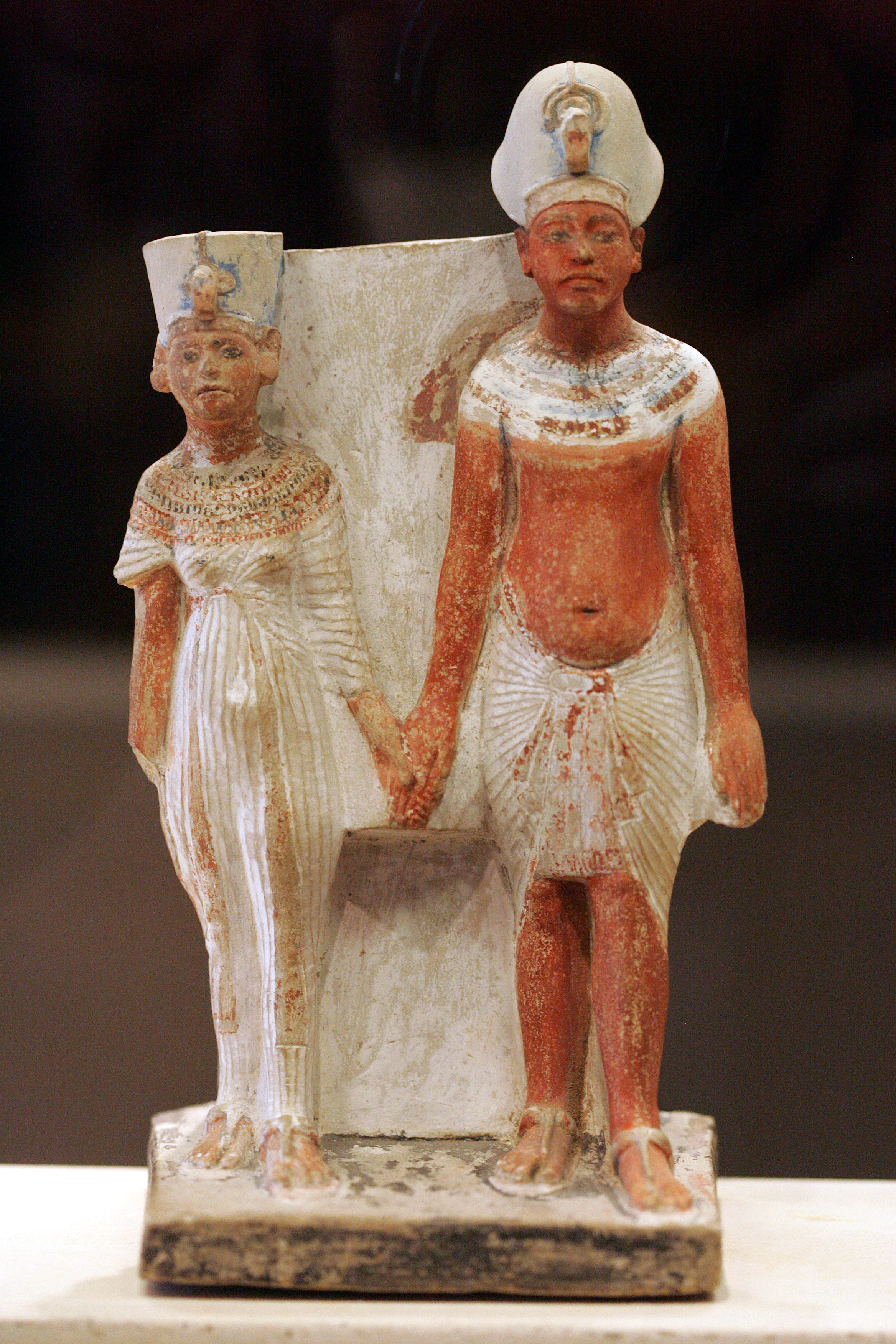 Painted limestone figurine of Akhenaten and Nefertiti, circa 1345 BC. In the collection of Louvre Museum, Paris, France. Photo taken on October 20, 2007.