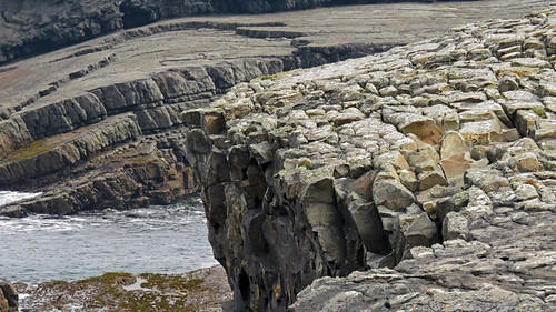Wildly textured rocky beach & cliffs at Bridges of Ross, Ireland