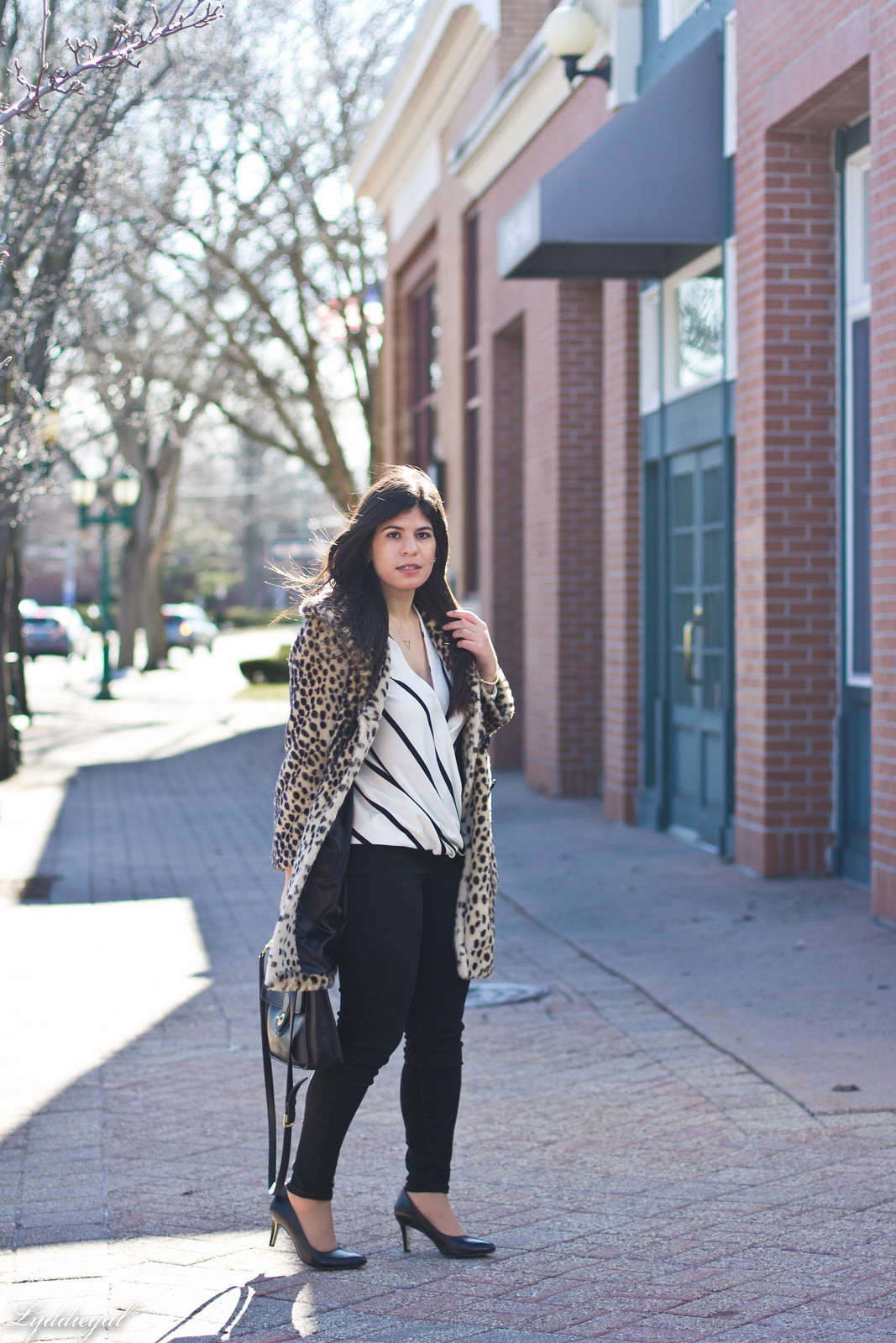 striped wrap top, black jeans, coach bag, leopard fur coat-17.jpg