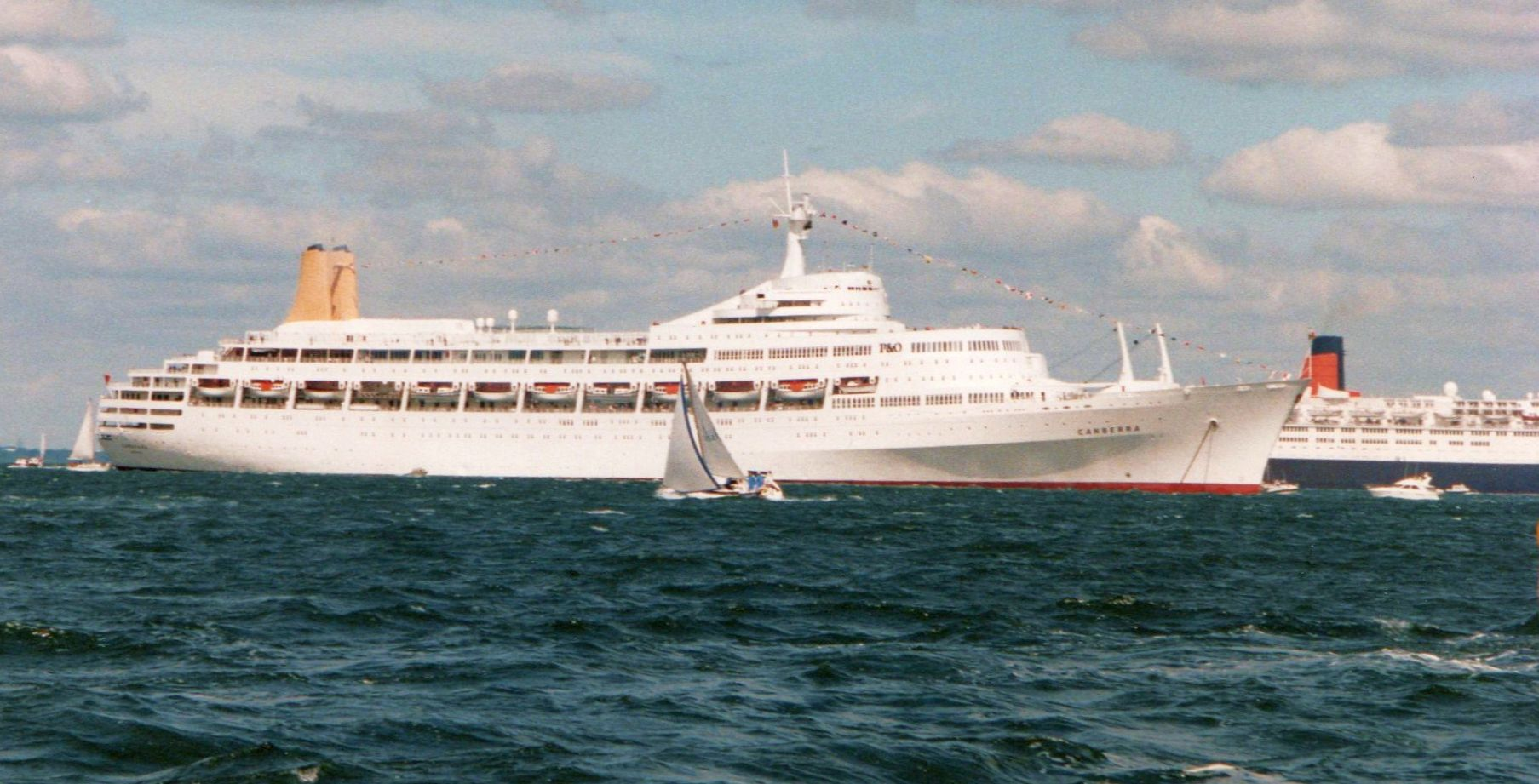 SS Canberra and RMS Queen Elizabeth 2 in the English Channel on June 5, 1984.