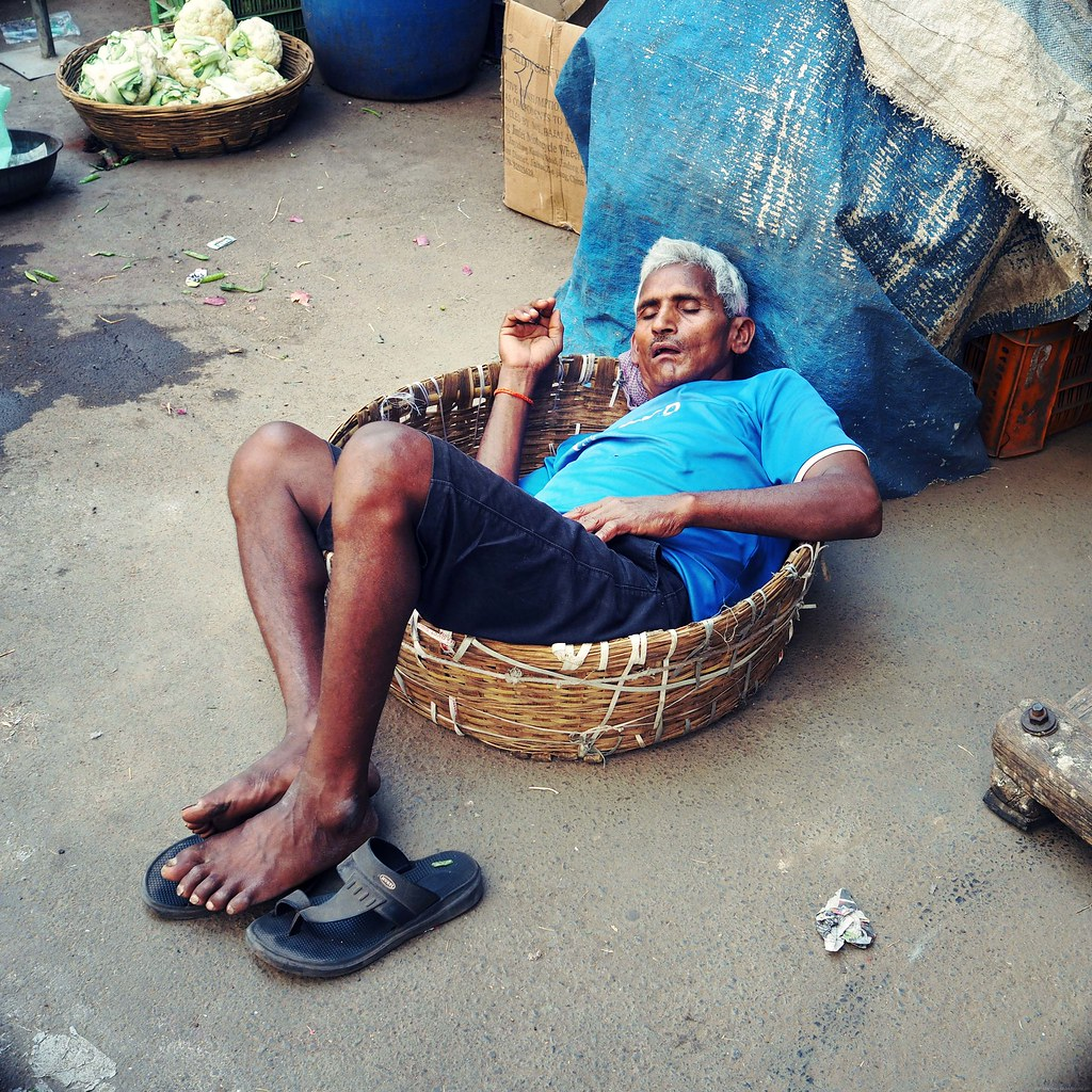 Sleeping Man in Basket Indian Market Mumbai Bombay_effected