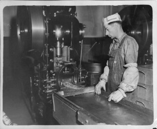 Denver Mint workman tends to the punching press,