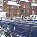 Canal boats moored in Gas Street Basin on a snowy day, Birmingham.