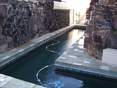 swimming pool(0.0), thermae(0.0), walkway(0.0), waterway(0.0), wall(1.0), water feature(1.0), water(1.0),