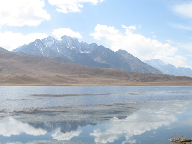 Mountains reflected in the waters of the lake at the top of the Shandur Pass (3)