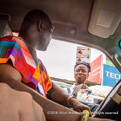 Being offered Ghanian chocolate by a street vendor while standing in traffic, Kwame Nkrumah Avenue, Accra Ghana