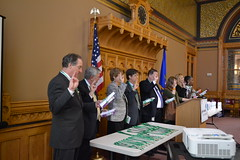 Reps. being sworn in as Honorary Girl Scouts