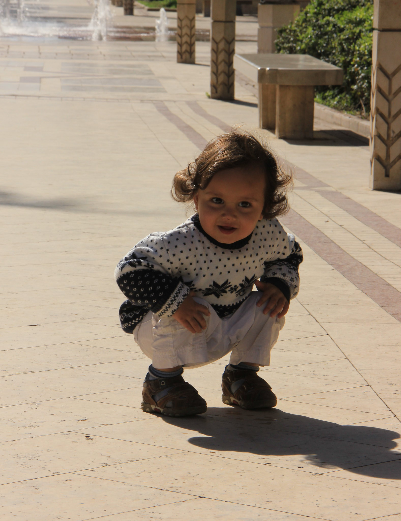 child playing in the sun in cairo