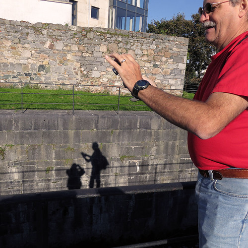 Taking pictures on our stroll along the river in Galway, Ireland