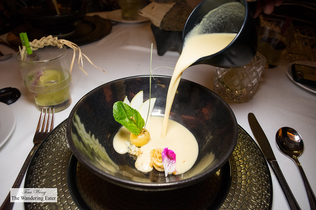 Corsage of pumpkin flowers in a toasted almonds tumeric cream soup