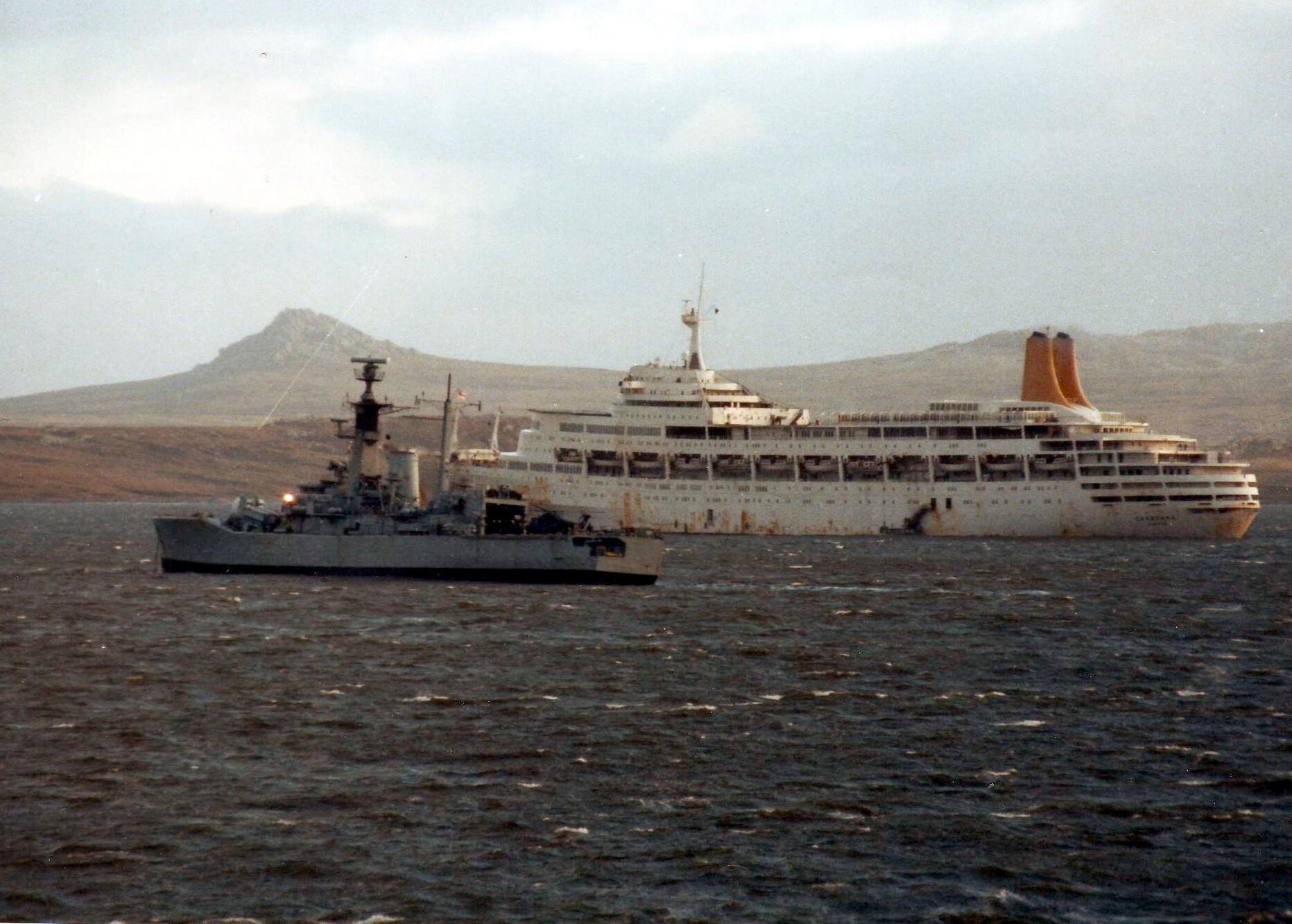 HMS Andromeda and Canberra off Port Stanley, Falkland Islands, just after the surrender of Argentine forces on June 14, 1982.