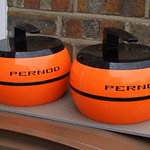 Tue, 2014-06-24 03:31 - A pair of Kitsch Vintage Bright Orange 1970's Pernod Ice Buckets Shaped Like Curling Stones