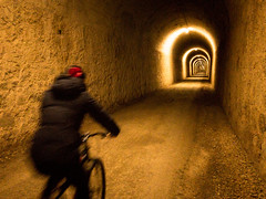 Cycling through an old railway tunnel - so long you can't see the exit