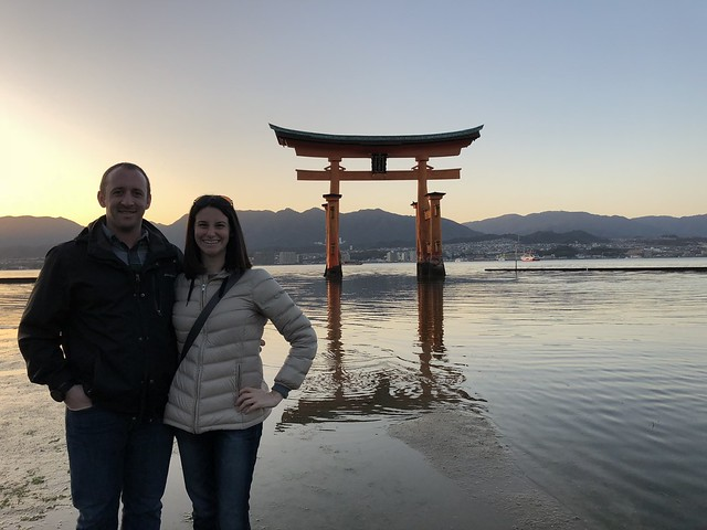 In front of the torii gate at sunset