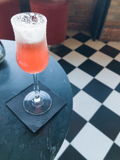 The Flapper - Ketel One Vodka, Di Saronno, lemon, pineapple, Angostura bitters, Moet & Chandon NV Champagne