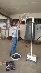 Tom working on a discarded surgical light on the first day in Mbarara regional referral hospital