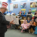 """In honor of Dr. Seuss' birthday and donning a """"Cat in the Hat"""" hat, State Representative Craig Fishbein recently spent part of a morning reading to 5th graders at Wallingford's Mary Fritz Elementary School.  Despite a winter storm, Rep. Fishbein was able to read two books – the Seuss classic """"What Pet Should I Get"""" and """"What Do You Do With An Idea?"""" by Kobi Yamada and illustrated by Mae Besom –  to Michelle Jones and Jenn Leonard's classes that were assembled inside the media center.  After he finished reading and talking to the students about his role in the legislature, Rep. Fishbein donated the Seuss book to the school and gave his hat to one lucky student.  Unfortunately, the storm caused the cancellation of opening night of Moran Middle School's production of """"Seussical"""", but the kids at Mary Fritz Elementary were entertained by the group who were roaming the halls and performing songs from the show."""