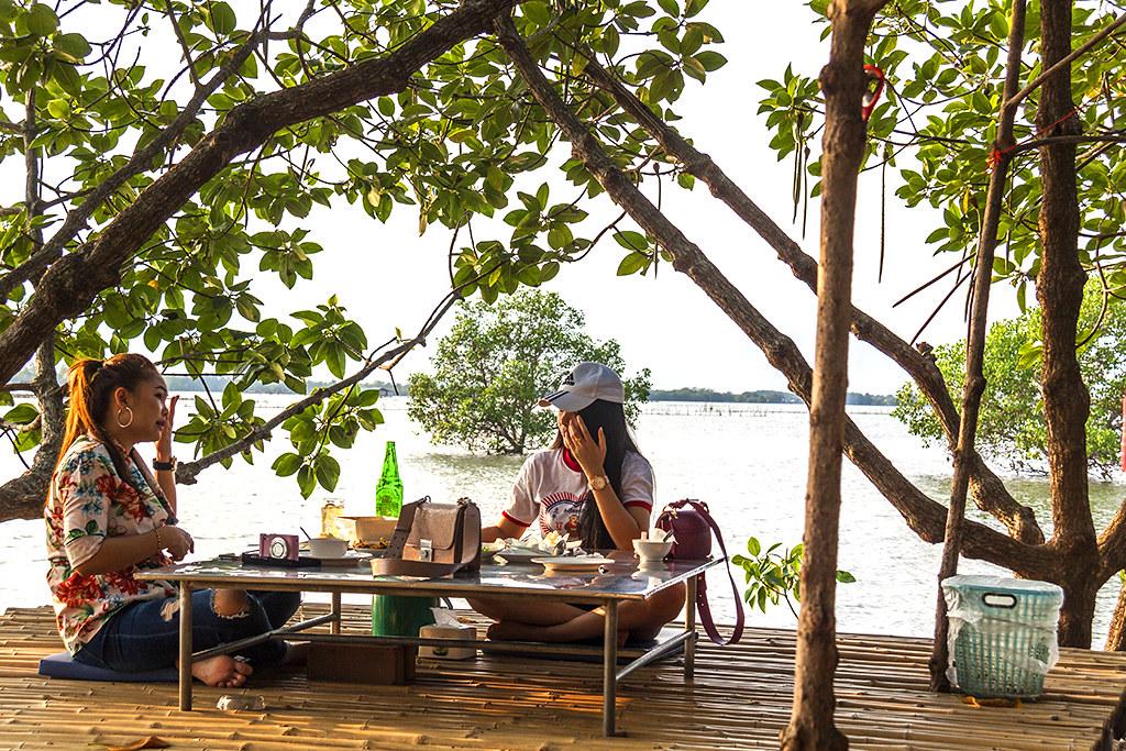 Two women at riverside restaurant--Chanthaburi