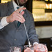 Stirring the Peychaud's bitters in Blossom Milk Punch