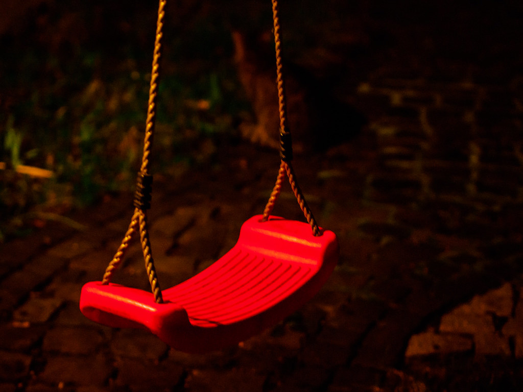 Red swing at night