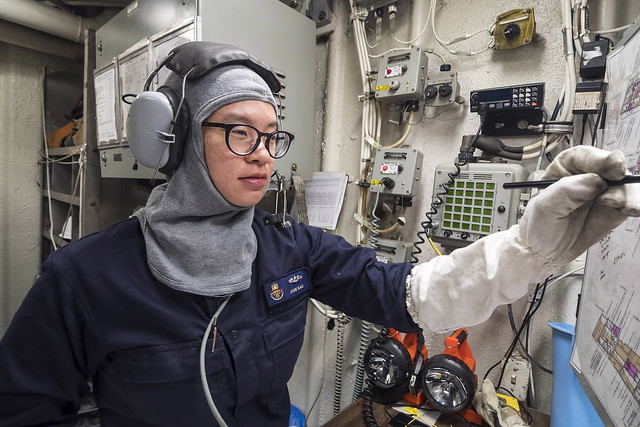PHILIPPINE SEA (March 20, 2018) Fire Controlman 2nd Class Jodie Kao, assigned to the guided-missile cruiser USS Antietam (CG 54), plots boundaries in repair locker five during an integrated training team environment (ITT). USS Antietam is forward-deployed to the U.S. 7th Fleet area of operations in support of security and stability in the Indo-Pacific region. (U.S. Navy photo by Lt. j.g. Marissa Liu/Released)