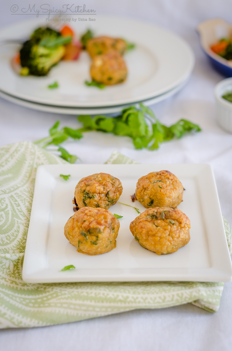 A plate of healthy baked chicken kofta or meatballs seasoned with Indian spices