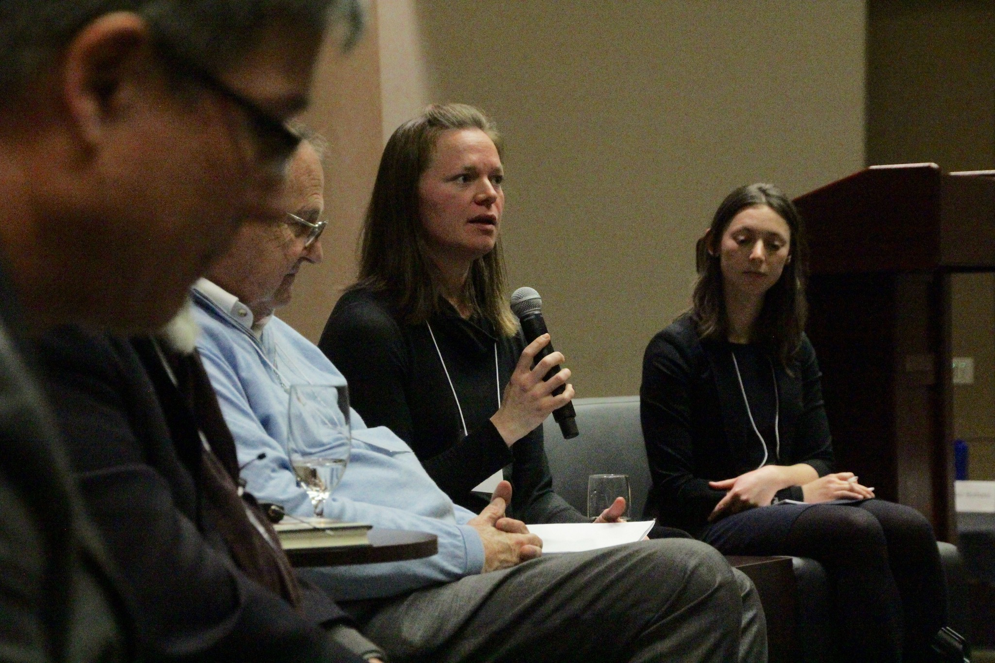 Alissa Cordner of Whitman College, center, answers an audience question.