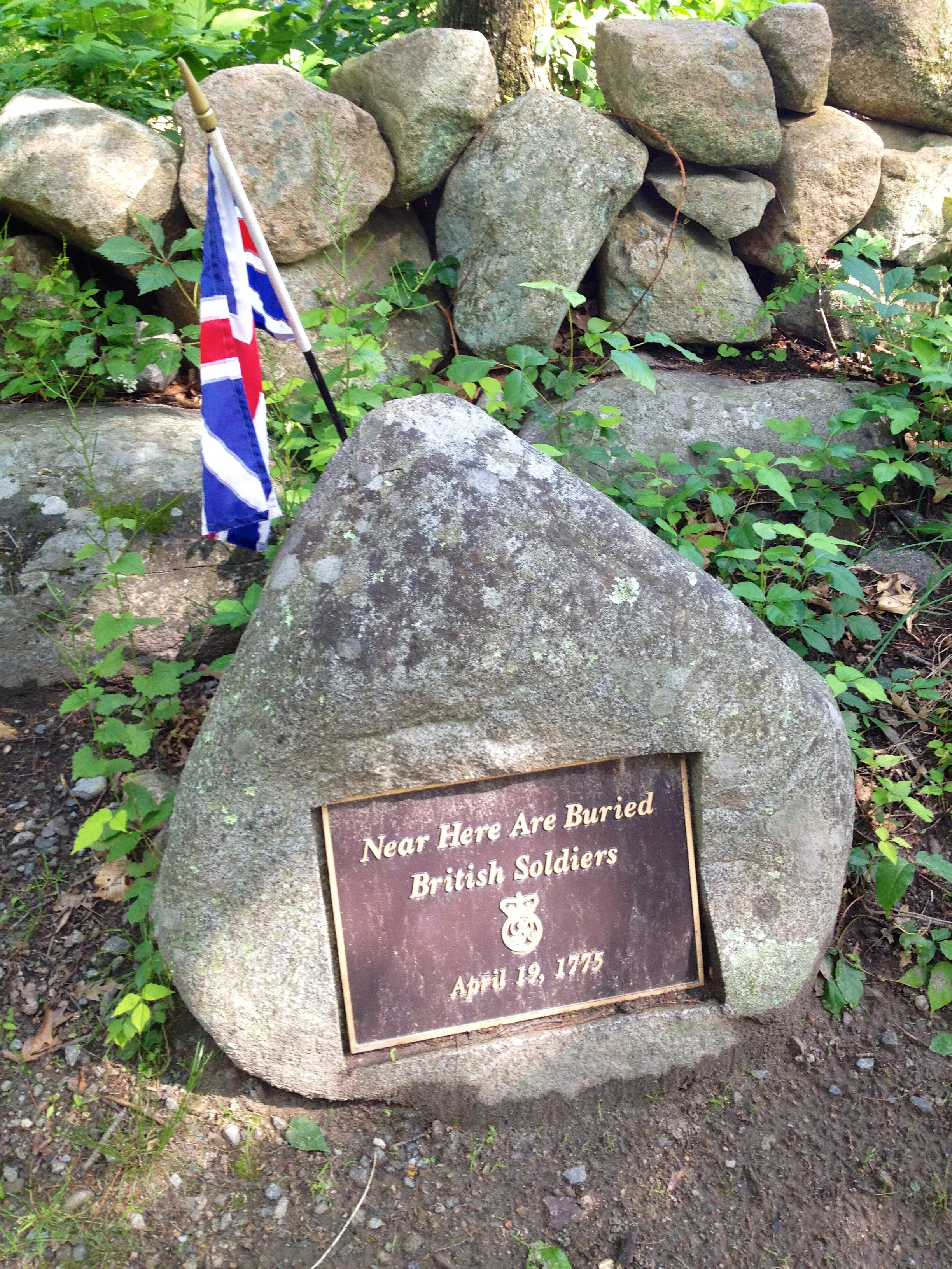 Grave marker of British Soldiers along Battle Road in Lexington, marking the burial sites of British soldiers that died during the Battle of Lexington and Concord, April 19, 1775. The markers are maintained with Britain's 1775 version of the Union Flag. Photo taken on June 7, 2012.