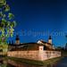 Nesvizh, Minsk Region, Belarus. View Of Niasviz Castle Or Nesvizh Castle Under Night Starry Sky. Residential Castle Of Radziwill Family. UNESCO World Heritage Site