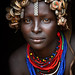 Portrait Of A Young Dassanech Woman Wearing Bottle Caps Headgear And Beaded Necklaces Omo Valley Ethiopia by Eric Lafforgue