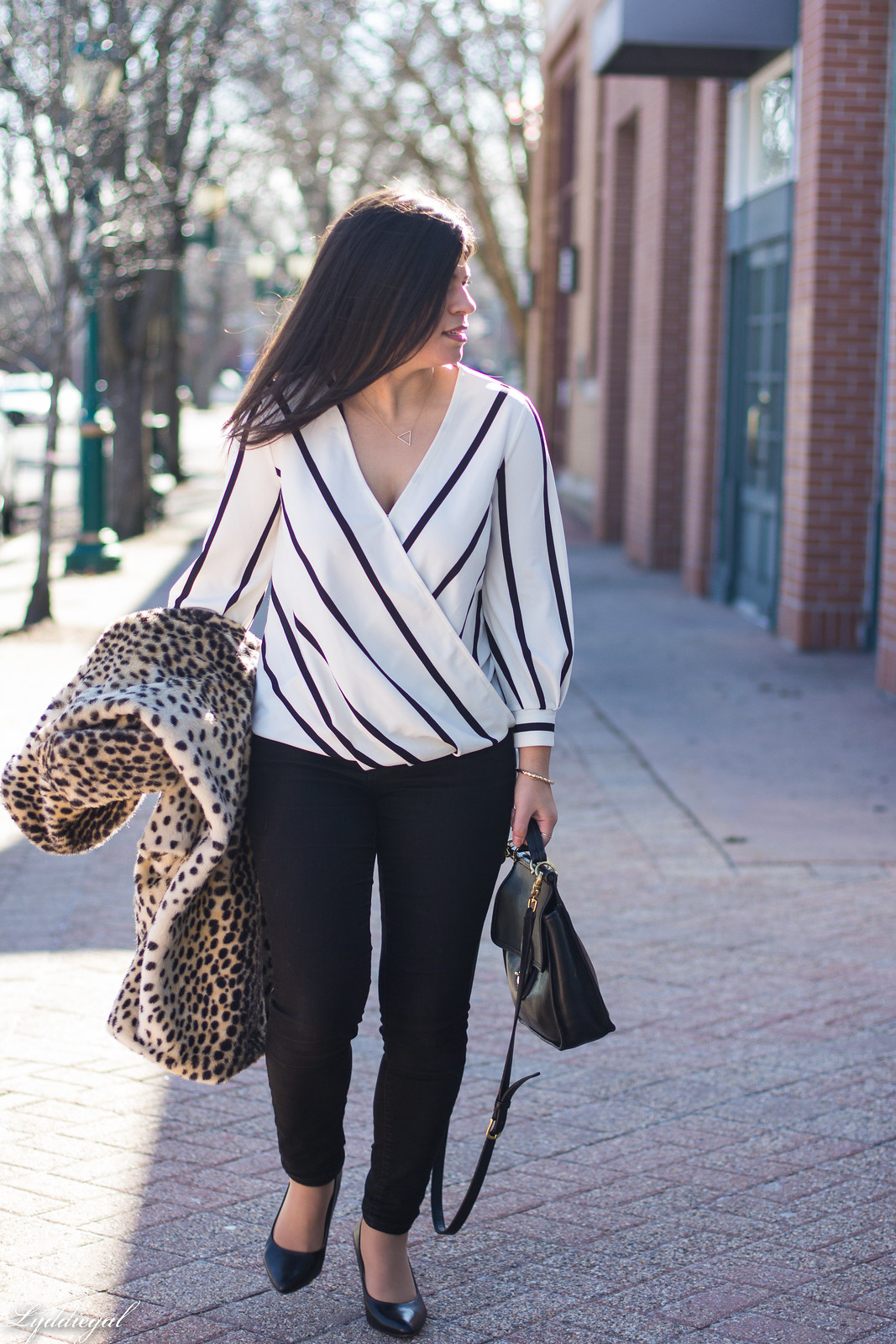 striped wrap top, black jeans, coach bag, leopard fur coat-20.jpg