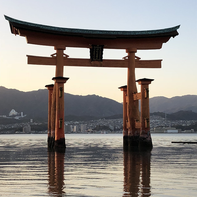 Floating torii gate at dusk