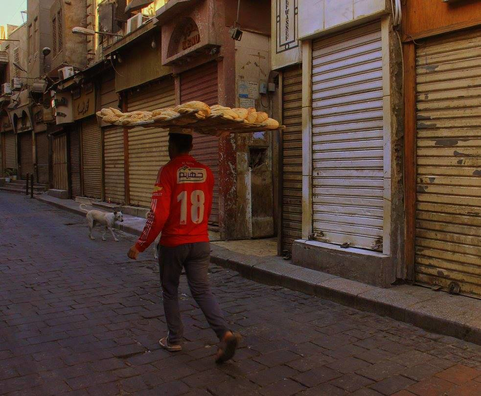Bread sellers are popular Cairo street photography subjects