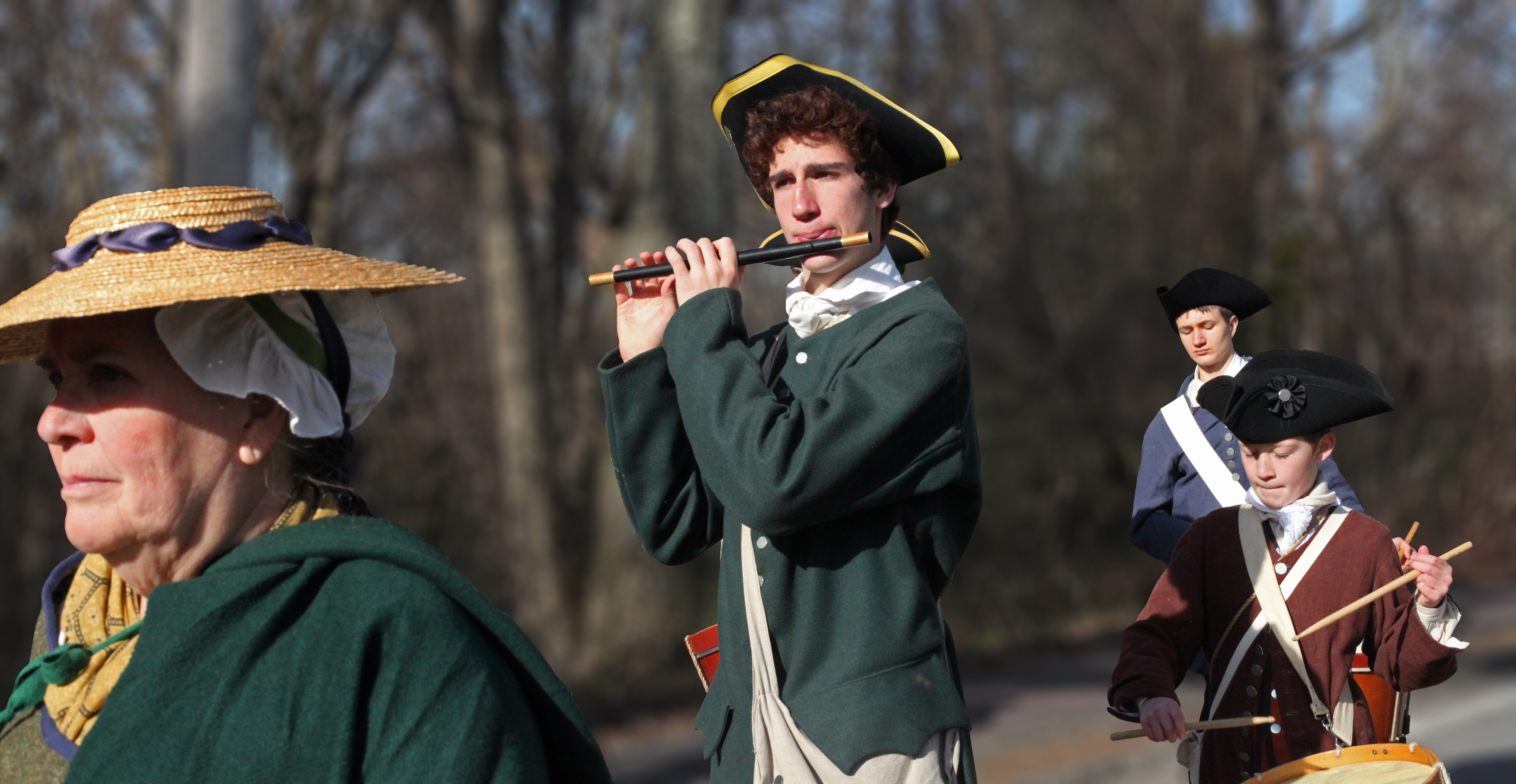 A citizen of Acton and Members of the Acton Fife and Drum Corps march to Concord on the Isaac Davis Trail during the 2016 annual Patriots' Day celebration.