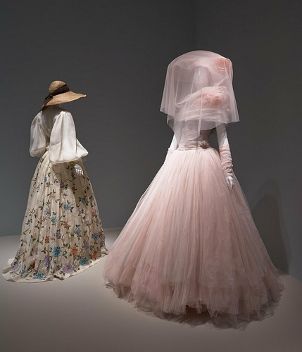 (L): Oscar de la Renta for Pierre Balmain, Evening Ensemble, spring/summer 2000, silk organza, silk, metallic thread and bead embroidery, and silk applique. Installation view of The Glamour and Romance of Oscar de la Renta at the Museum of Fine Arts, Houston, October 8, 2017–January 28, 2018. Photo by Thomas R. DuBrock. (R): Oscar de la Renta for Pierre Balmain, Evening Ensemble, spring/summer 1997, silk and silk tulle. Installation view of The Glamour and Romance of Oscar de la Renta at the Museum of Fine Arts, Houston, October 8, 2017–January 28, 2018. Photo by Thomas R. DuBrock.