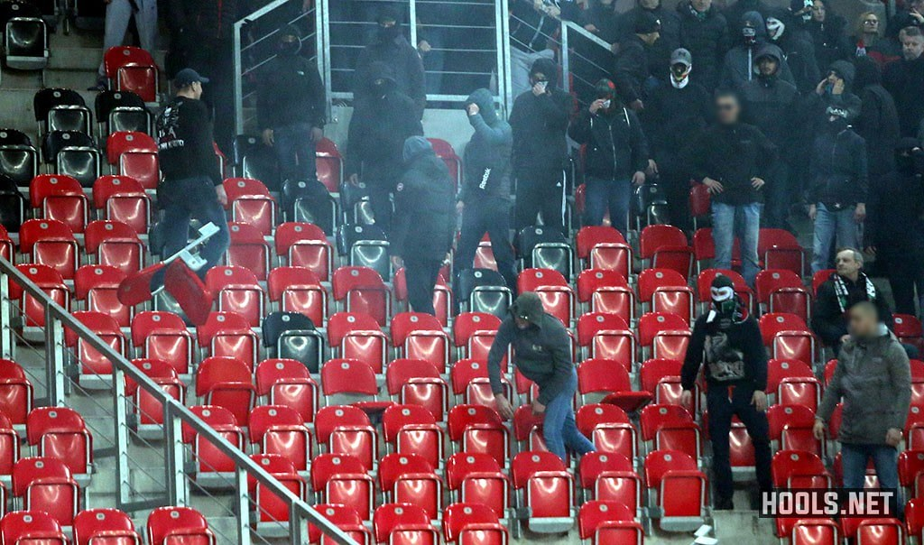 A GKS Tychy fan throws a seat towards cops during the game against Ruch.