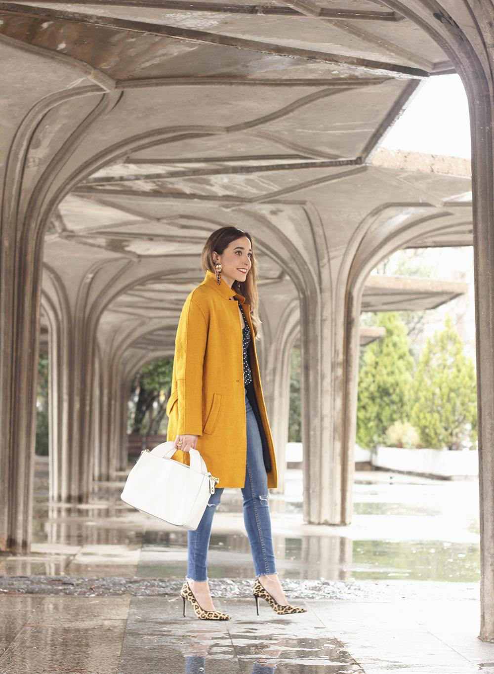 mustard coat polka dots shirt leopard heels white bag outfit 01