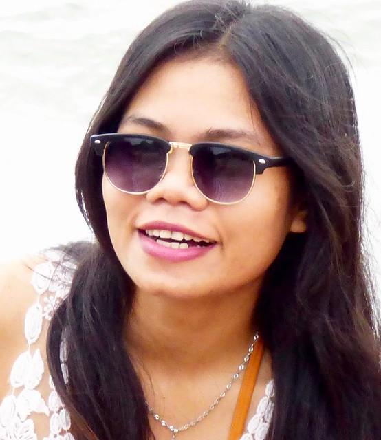 Indonesian girl on Kuta beach .