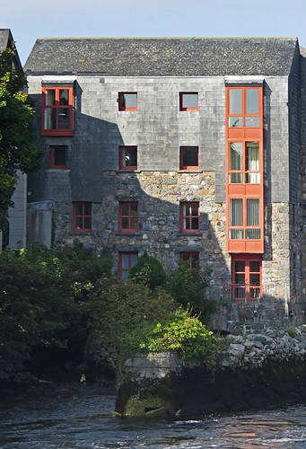 Stone apartment building along the river in Galway, Ireland