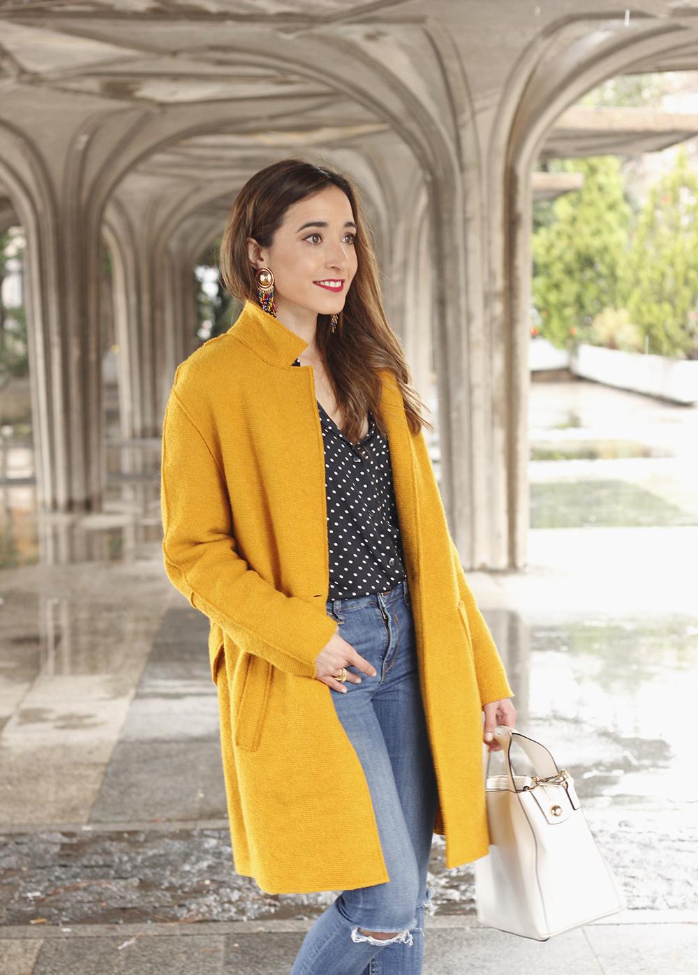 mustard coat polka dots shirt leopard heels white bag outfit 10
